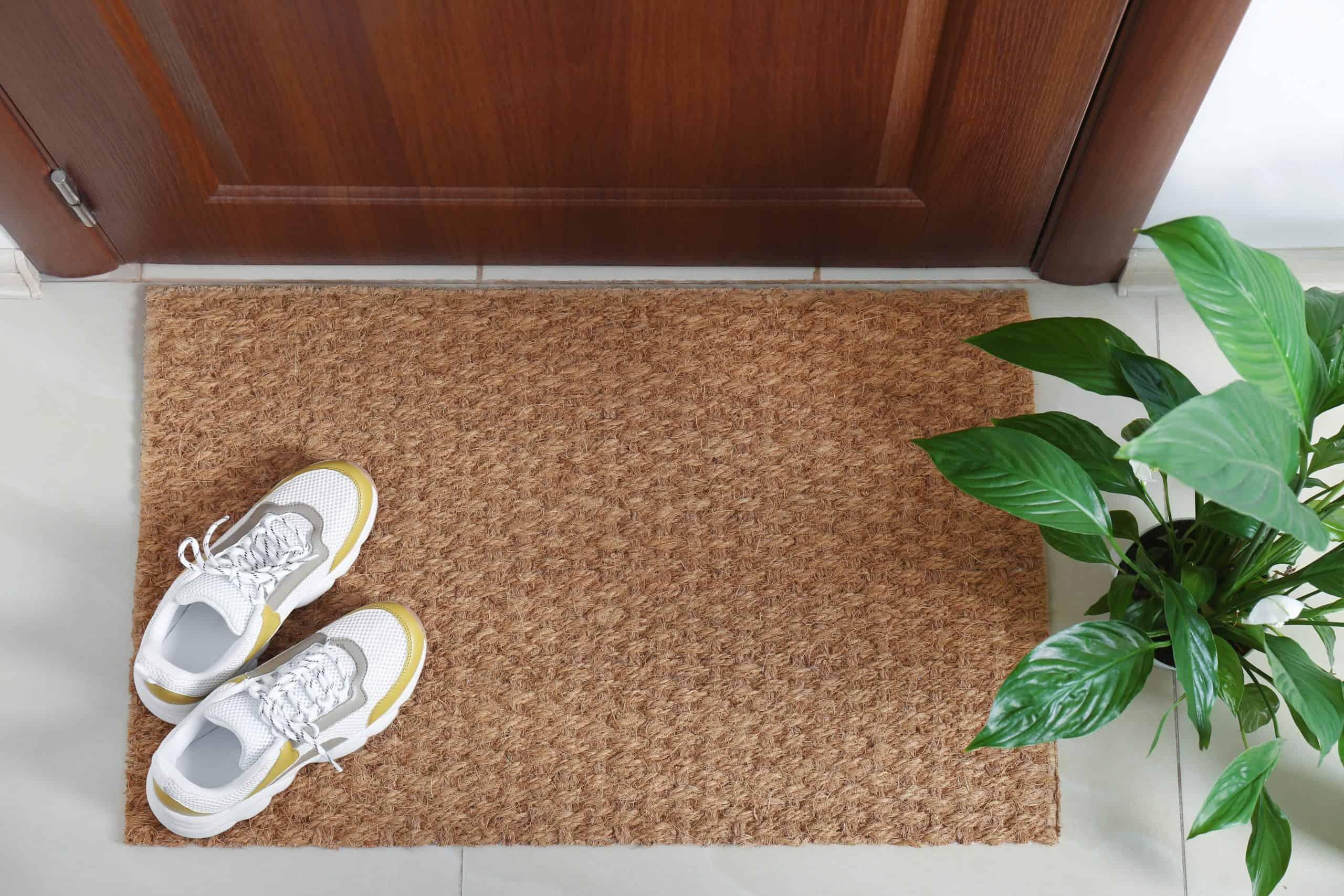 sneakers by the front door mat